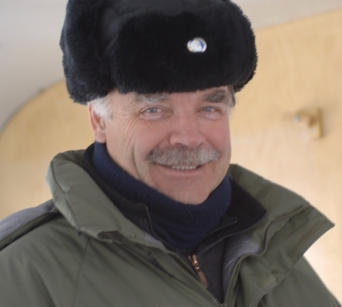 Author Glenn Hopfner dressed for the northern climes with parka and fur hat.