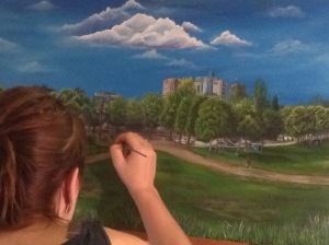 Artist Laura Lee Harasym painting the Forks in Winnipeg